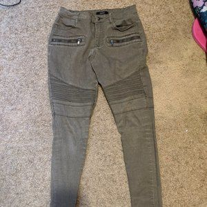 army green jeans with zippers at ankles
